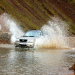 Stock Photo: Off-road car wading in Landmannalaugar
