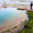 Stock Photo: Blue pool with grass in Geysir