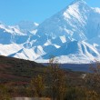 Stock Photo: AlaskRange and hilly road in Denali National Park