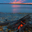 Lit campfire on the shore — Stock Photo #33110851