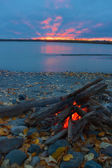 Lit campfire on the shore — Foto Stock