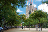 Sagrada Familia from green park with people — Stok fotoğraf