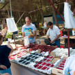 Sellers on outdoors market in Lloret de mar selling fruits — Stock Photo