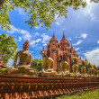 Patten of buddha wall with three foreground and chapel in thailand — Stock Photo