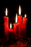 Light Five Red candles with black background — Stock Photo