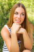 Young woman in the park — Stock Photo