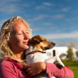 Happy girl holding a dog — Stock Photo