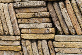 Stone wall made out of uneven bricks — Stock Photo