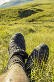 Muddy legs in green environment — Stock Photo
