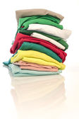 Pile of shirts isolated — Stock Photo