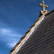 Celtic cross on the roof of ancient church — Stock Photo