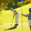 Women playing golf — Stock Photo
