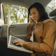 Businesswoman in car — Stock Photo