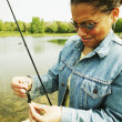 Female fisher — Stock Photo