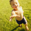 Boy Running Through Grass — Stockfoto