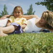 Mother And Daughter Laying on Grass — Stock Photo