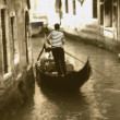Gondolier riding gondola. — Stock Photo