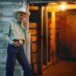 Cowboy Stands By Door — Stock Photo