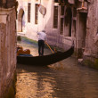 Gondolier riding gondola — Stock Photo