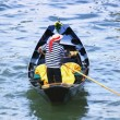 Stock Photo: Gondolier Navigating Canal Of Venice Italy Europe