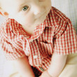 Stock Photo: Baby In Red Plaid Shirt