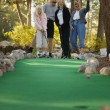 Family Goes Mini Golfing — Stock Photo #31605071