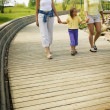 Stock Photo: Three Girls Walking In Park