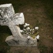 Stock Photo: Headstone With Flowers