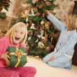 Foto Stock: Child At Christmas With Present