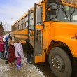 Stock Photo: Elementary Schoolchildren Boarding School Bus On A Cold Winter Day In Edmonton Alberta Canada