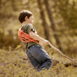 Foto Stock: Young Boy Walking Through Woodland
