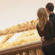 Couple Look Out Over City — Stock Photo