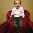 Stock Photo: Child Stands On Chair