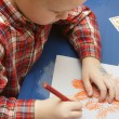 Stock Photo: Little Boy In Kindergarten Drawing Halloween Picture In His Class