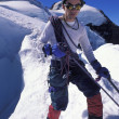 Mountaineer On Snowy Slope — Stock Photo #31609797