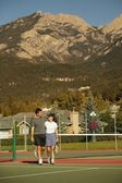 Couple In Tennis Court — Stock Photo