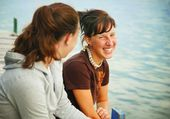 Two Girls Sitting On A Pier — Stock Photo