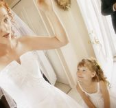 Flower Girl Admires The Bride — Stock Photo