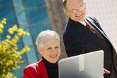 Two Business People Looking At A Laptop — Stock Photo