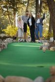Family Goes Mini Golfing — Stock Photo