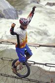 Unicyclist Crossing River On Unicycle — Stock Photo