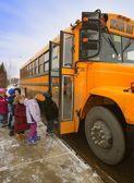 Elementary Schoolchildren Boarding School Bus On A Cold Winter Day In Edmonton Alberta Canada — Stock Photo