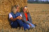 Mom And Daughter In Hayfield — Stock Photo