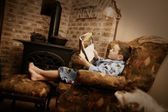 Young Boy Relaxing With Book — Stock Photo