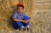 Young Boy Relaxing In Hayfield — Stock Photo