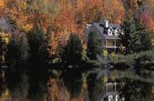 House On Lake In The Fall — Stock Photo