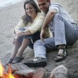 Couple Keep Warm By Campfire — Stock Photo