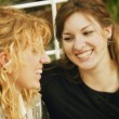 Stock Photo: Two Women Laugh Together