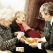 Elderly Women Having Cookies — Stock Photo #31611625