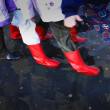 Rubber Boots In Puddle — Stock Photo